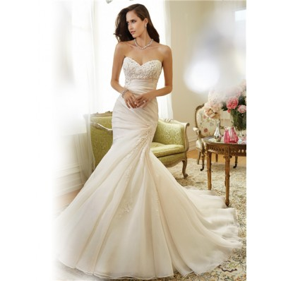 fit and flare mermaid strapless asymmetrically draped